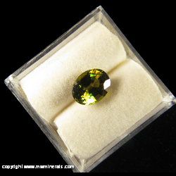 Minerals Specimen: Titanite (Sphene) Cut Gemstone - Green with Orange Flashes from Madagascar