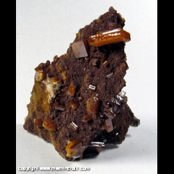Mineral Specimen: Vanadinite, Descloizite on Barite from Los Lamentos, Chihuahua, Mexico